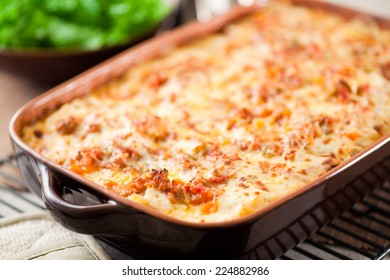 Baked lasagna still bubbling hot. Ragu sauce was simmered for hours, layered with bechamel sauce, lasagna noodles and parmesan cheese. Truly delicious!