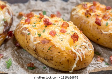 Baked loaded potato with bacon, cheese, sour cream and onion