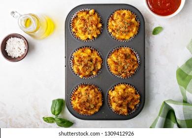 Baked mac and cheese muffins with marinara sauce