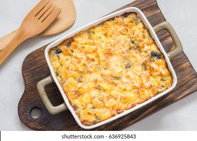 Baked macaroni casserole in a ceramic baking dish. Top view.