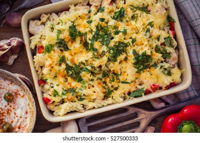 Baked macaroni with chicken and mushrooms