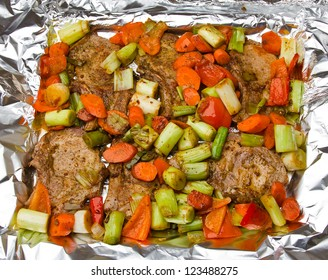 The baked Meat in a foil with vegetables