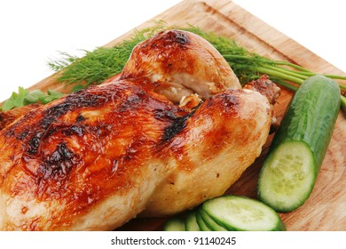 baked meat : fresh whole chicken with black olives and raw tomatoes on wooden board isolated over white background