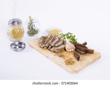 baked meat on the Board, with spices and bread. on a white background.