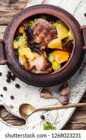 Baked meat with vegetables in clay pots