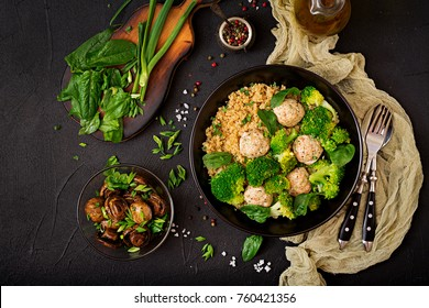 Baked meatballs of chicken fillet with garnish with quinoa and boiled broccoli. Proper nutrition. Sports nutrition. Dietary menu. Flat lay. Top view