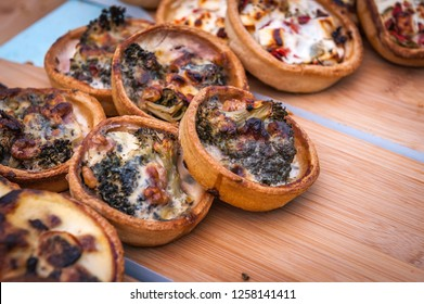 Baked mini quiche pies with broccoli and cheese.