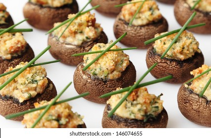 Baked mushroom caps stuffed with sausage, cheese, and spices.