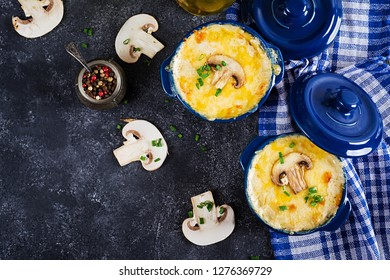Baked mushroom julienne with chicken and cheese in  pots. Top view