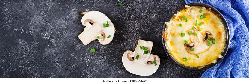 Baked mushroom julienne with chicken and cheese in  pots. Banner. Top view