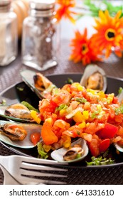 Baked mussels with  tomato sauce and vegetable