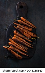 baked organic carrots with thyme on a grill,organic vegan food
