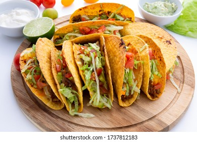 baked oven beef taco with tomato, lemon and lettuce