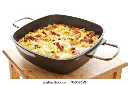 baked pasta with ham and cheese Italian food