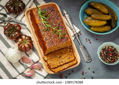 Baked pate with green lentils on a wooden tray