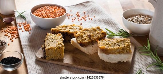 Baked pate of red lentils on a rustic background. Vegetarian pate.