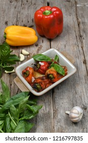 baked peppers dishes on the wooden tabletop view