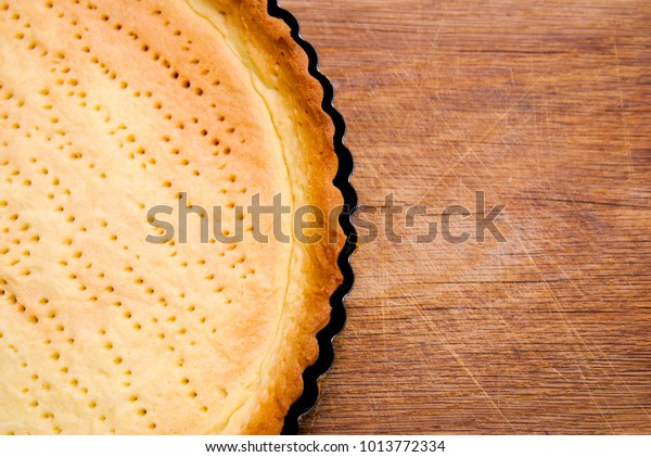 Baked Pie Base Pastry made orr Pie or Tart or Cake Dessert from. Dough in tart Pan.