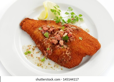 Baked plaice with bacon butter on plate
