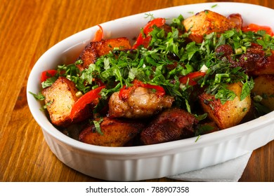 Baked pork with potato and herbs