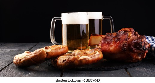 Baked pork shank and honey sause and glass of beer