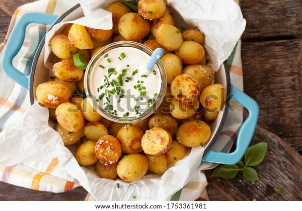 Baked potaoes with with a jar of sour cream