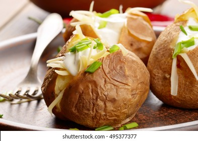 Baked Potato with chives, cheese, and sour cream