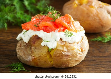 Baked potato with cream of the cream cheese and salted salmon, closeup.
