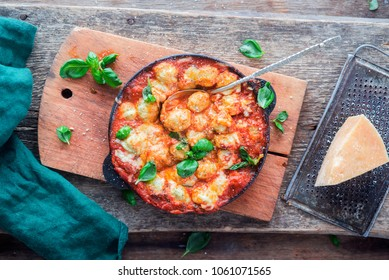 Baked potato gnocchi in tomato sauce