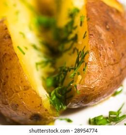 Baked potato with greens macro shot