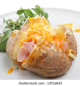 Baked potato with ham, cheese and watercress