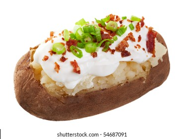 A baked potato loaded with sour cream, bacon bits, and chives.  Shot on white background.