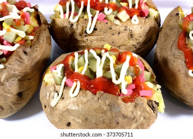 baked potato mixed with salad isolated
