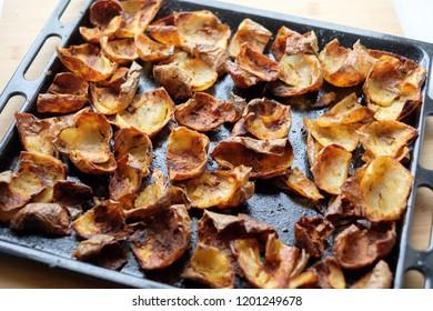 Baked potato skin crisps on a tray