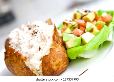 Baked potato with tuna filling and salad