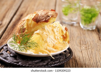 Baked potato with two kinds of cheese