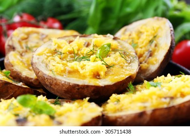 Baked potatoes with cheese and mushrooms on plate close up