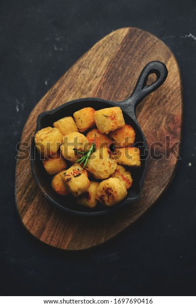 Baked potatoes in frying pan