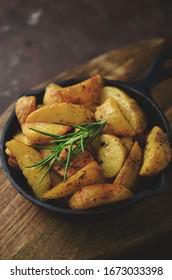 Baked potatoes on frying pan