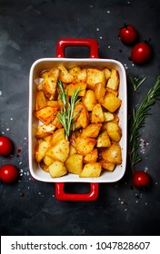 Baked potatoes with spices and rosemary, top view