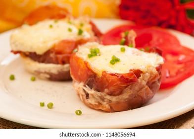 baked proscuitto egg cups with tomato, a ketogenic diet meal
