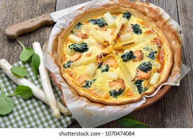 Baked quiche with fresh white asparagus, smoked salmon and spinach