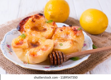 Baked quince with honey in a bowl, food