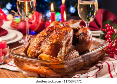 Baked or roasted whole chicken on Christmas table. Xmas dinner