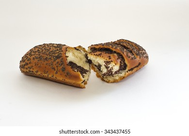 baked roll with poppy seeds and cuts