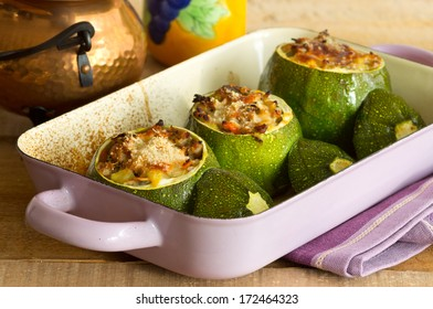 Baked round zucchini stuffed with minced meat, vegetables, and cheese