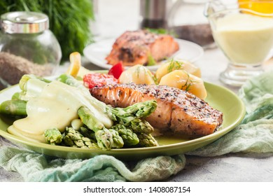 Baked salmon with asparagus and hollandaise sauce.Spring dish