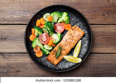 Baked salmon fillet with broccoli and vegetables mix.