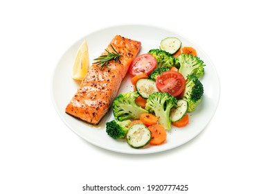Baked salmon fillet with broccoli and vegetables mix isolated on white background