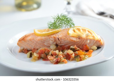Baked salmon with vegetables and lemon